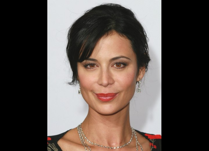 Catherine Bell wearing her hair pulled back and out of her face