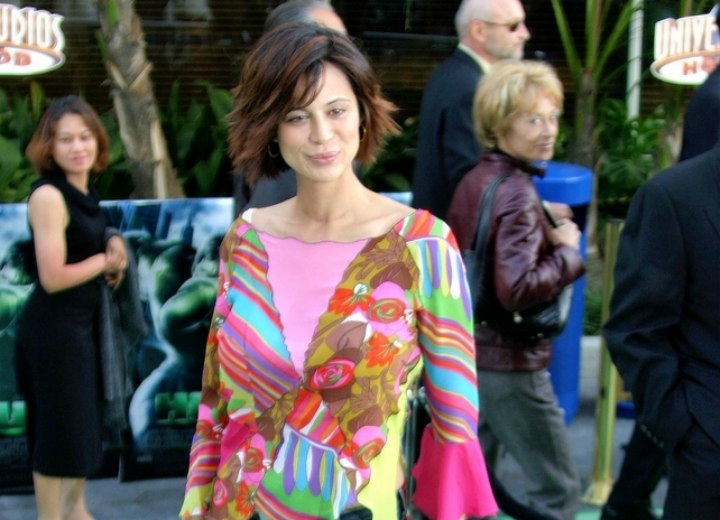 Catherine Bell wearing a colorful tunic blouse