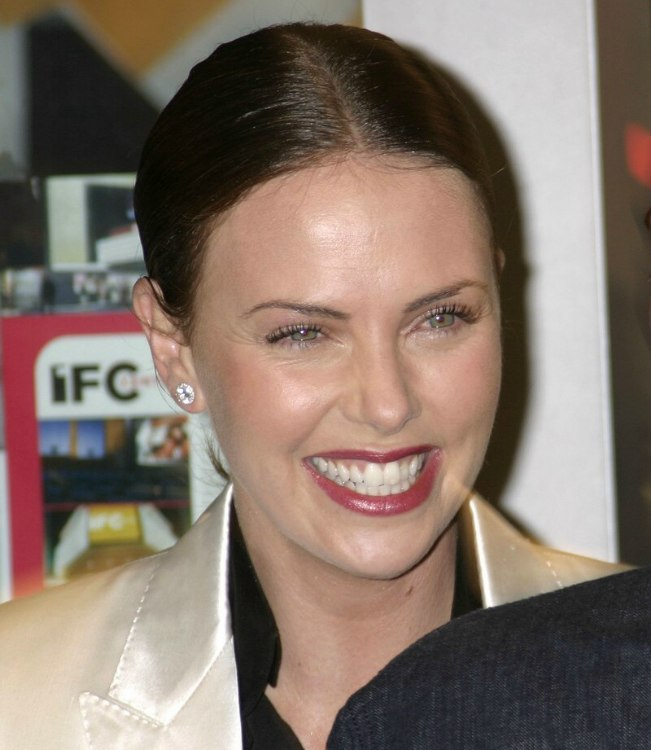 Charlize Theron Hair In A Severely Brushed Back Style And A Large