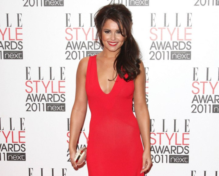 Cheryl Cole wearing a red low cut evening gown
