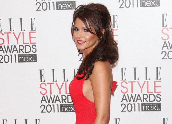 Cheryl Cole with her hair falling over one shoulder