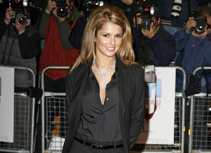 Cheryl Cole wearing a shirt and striped business suit