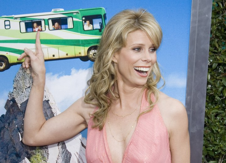 Cheryl Hines with her long hair styled into barrel curls