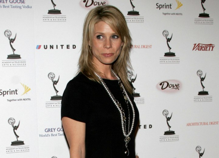 Cheryl Hines wearing a little black dress