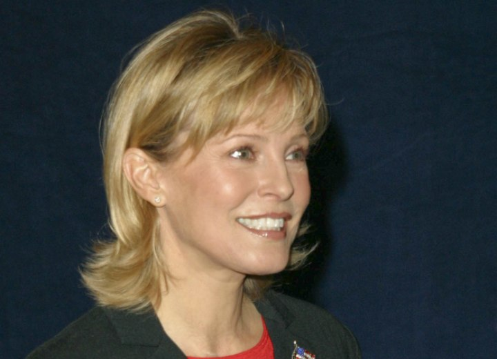 Side view of Cheryl Ladd's layered haircut with thinned out bangs