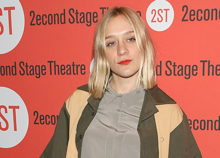 Chloë Sevigny wearing a silk shirt with the collar buttoned-up
