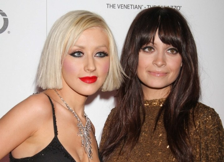 Christina Aguilera with short hair and Nicole Richie with long hair
