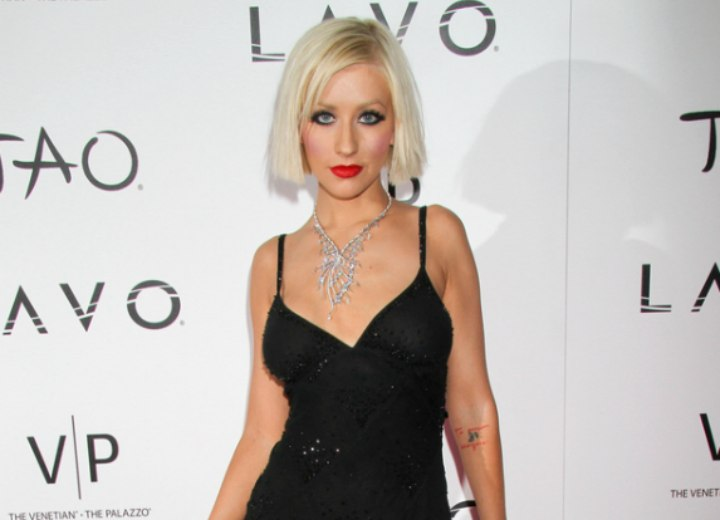 Christina Aguilera with short hair and wearing a little black dress
