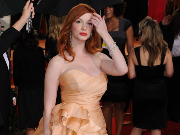Christina Hendricks wearing a long golden gown