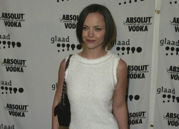 Christina Ricci wearing a white Charleston era inspired dress