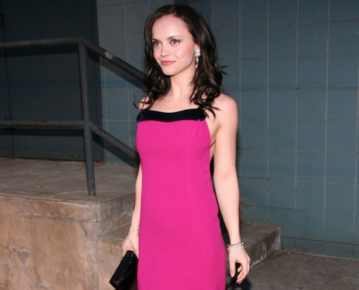 Christina Ricci wearing a long purple dress