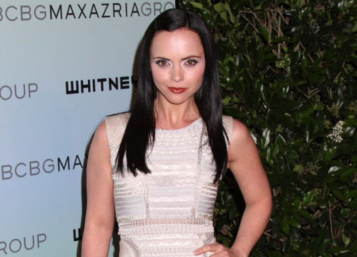 Christina Ricci wearing a dress with a rounded neckline