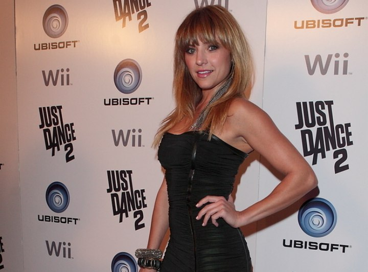 Christine Lakin wearing a short black dress
