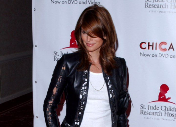 Cindy Crawford wearing a lacy black leather jacket