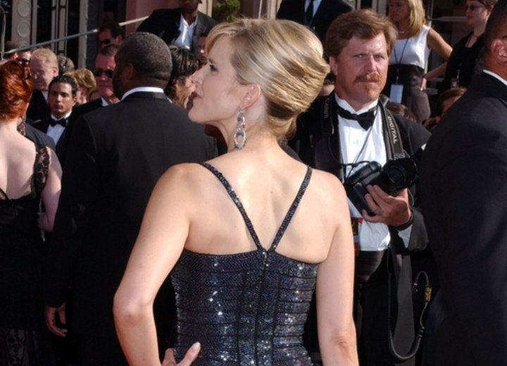 Side view of Courtney Thorne-Smith's up-style