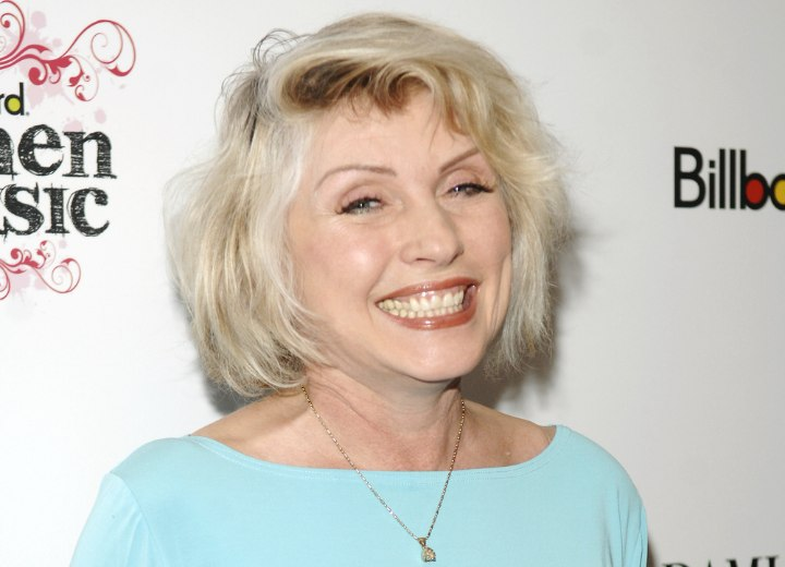 Modern bob hairstyle for a woman aged over 60 - Debbie Harry