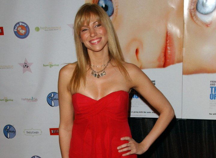 Deborah Gibson wearing a strapless red dress