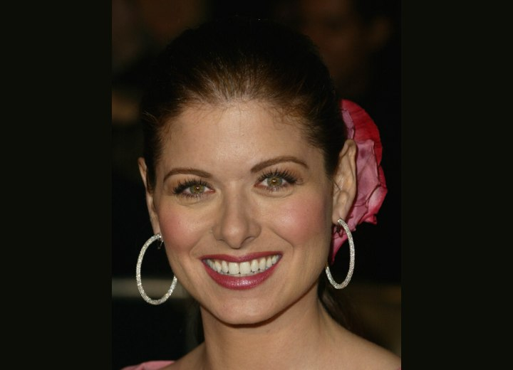 Debra Messing with her hair pulled back
