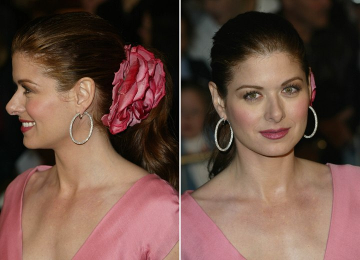 Debra Messing - Hairstyle with a large pink flower