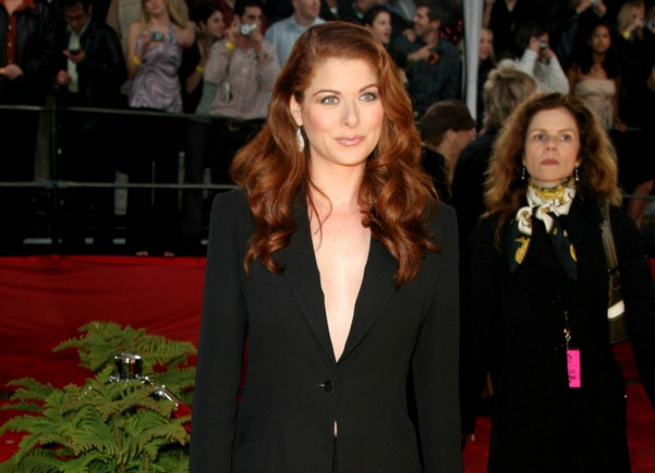 Debra Messing wearing a dark suit