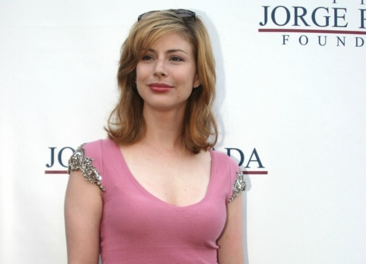 Diane Neal wearing a pink T-shirt and skirt
