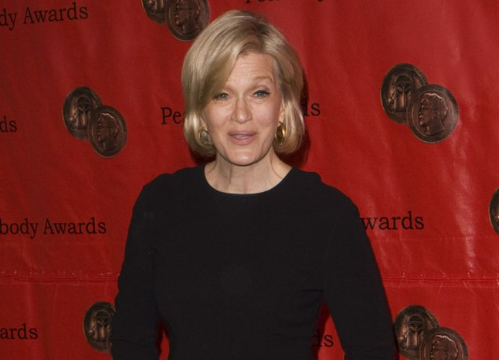 Diane Sawyer with just below the ears hair and wearing a black dress