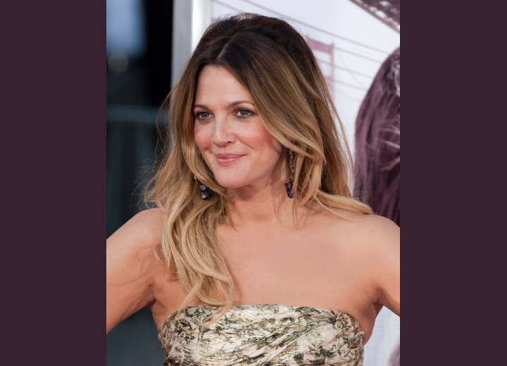 Drew Barrymore wearing one side of her long hair behind her shoulder