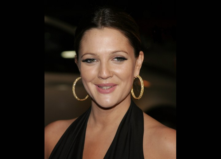 Drew Barrymore with her hair styled severely back