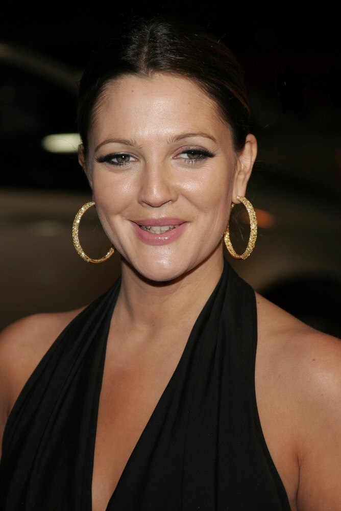 Drew Barrymore Wearing Her Hair Brushed Back In A Bun With