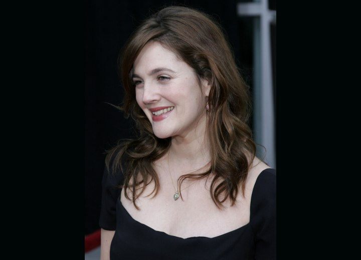 Side view of Drew Barrymore's long layered hairstyle