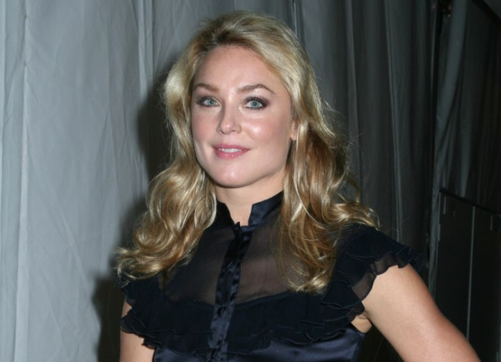 Elisabeth Rohm with a silk blouse and wearing her hair down