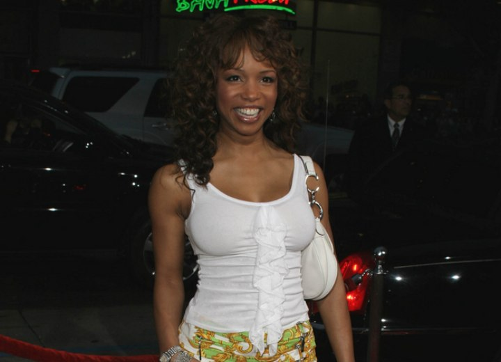 Elise Neal wearing a knee length skirt and white top