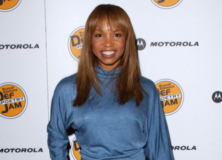 Elise neal wearing a light blue turtlenck top