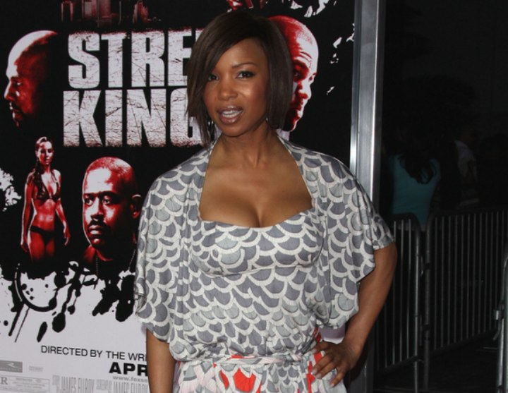 Elise Neal wearing white knee length boots