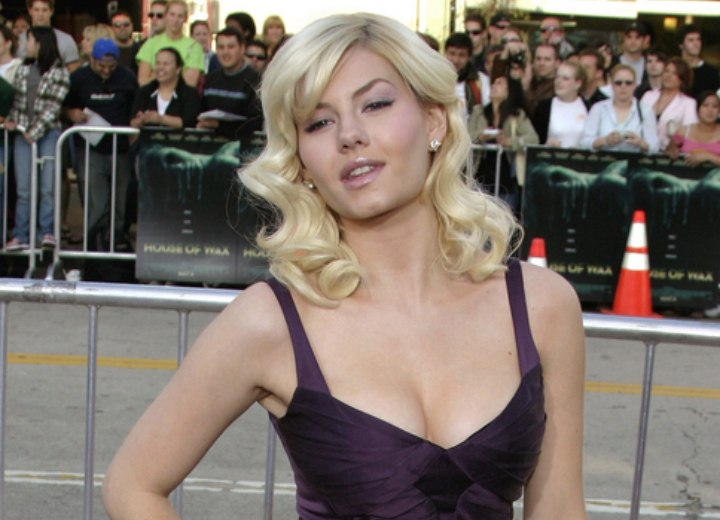 Elisha Cuthbert wearing a purple silk knee length dress