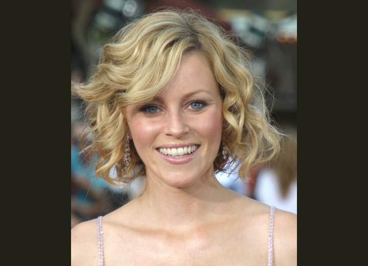 Elizabeth Banks wearing a mid-neck length bob haircut with curls