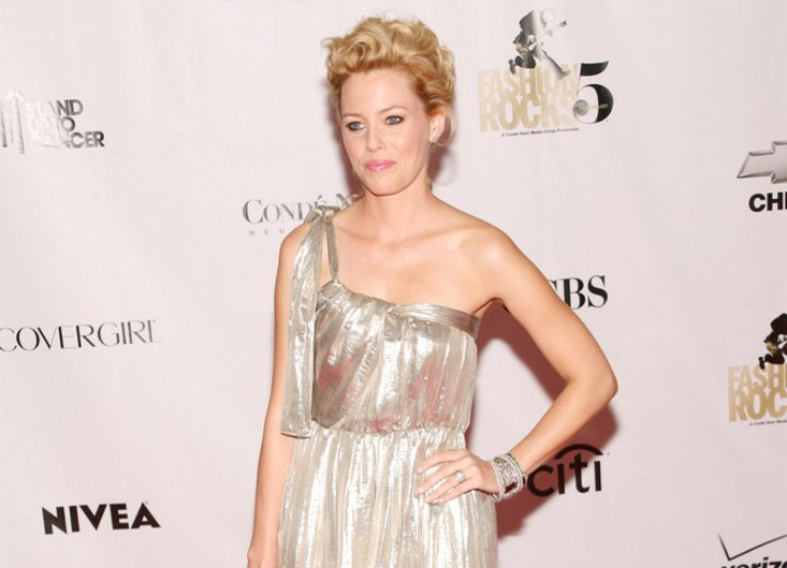 Elizabeth Banks wearing a short silver dress