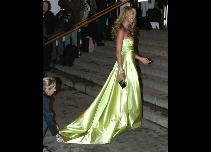 Elle MacPherson wearing a lemon green evening gown