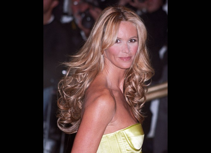 Elle MacPherson - Long hair with billowy curls and a centered part