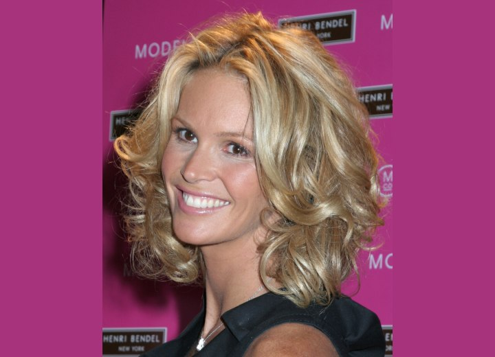 Side view of Elle MacPherson's medium hairstyle with curls