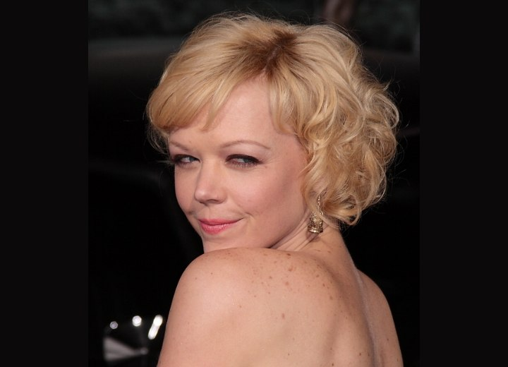Side view of Emily Bergl's short curly hairstyle