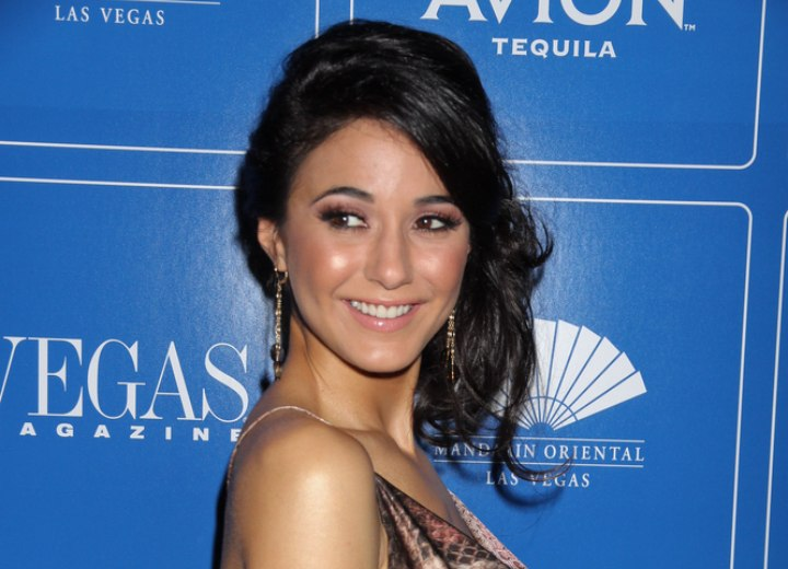 Emmanuelle Chriqui wearing her hair in a semi-updo with curls