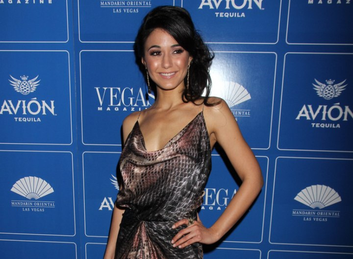 Emmanuelle Chriqui wearing a snakeskin pattern dress with a loose neck