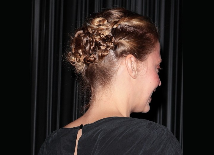 Estella Warren wearing her hair in an up-style with braiding