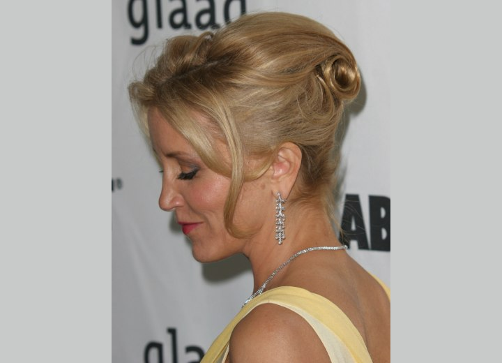 Side view of Felicity Huffman's updo with a barrel curl