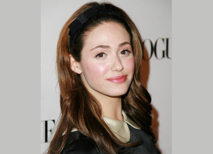 Long hair combed back and secured with a hairband - Emmy Rossum