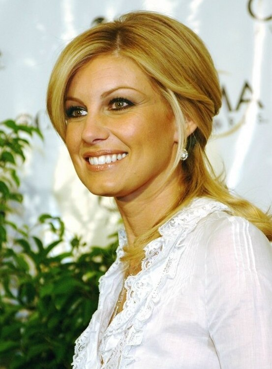 Faith Hill With Her Long Hair Tied Back Closely To The Head