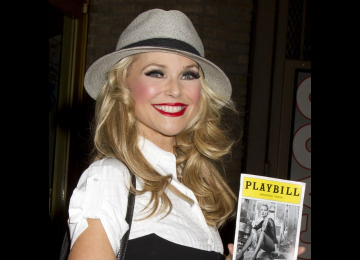 Christie Brinkley - Long blonde hair with curls combined with a hat