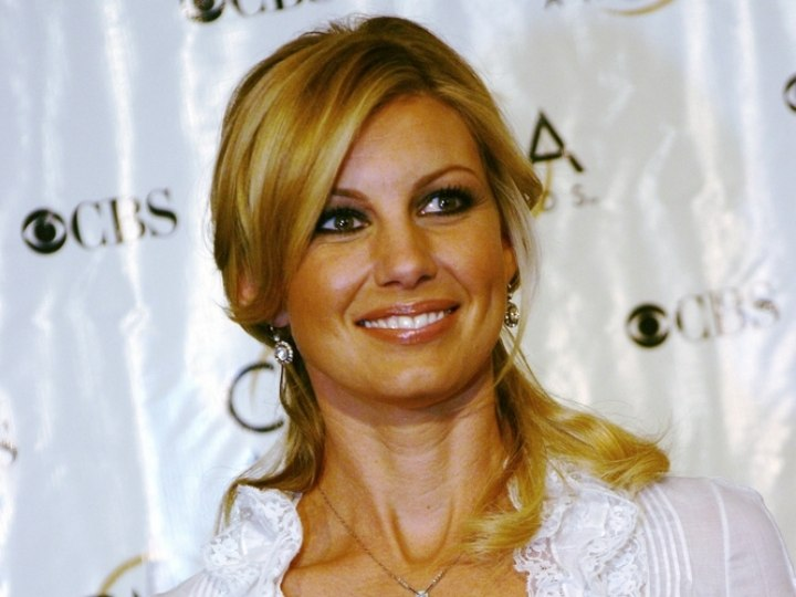 Faith Hill wearing her in a loose semi updo