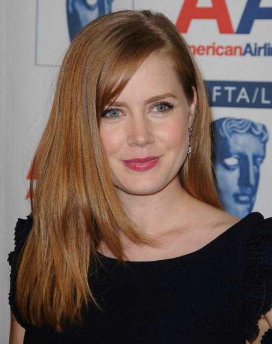 Amy Adams with her long reddish brown hair parted on the ...